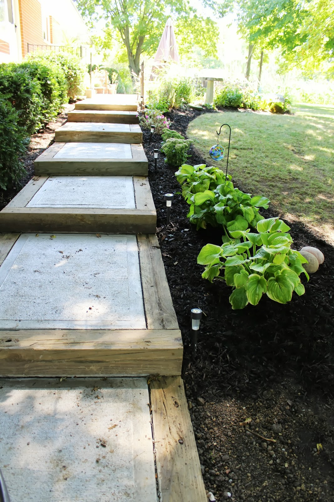 Diy garden stepping stones my list of lists for Landscape your own garden