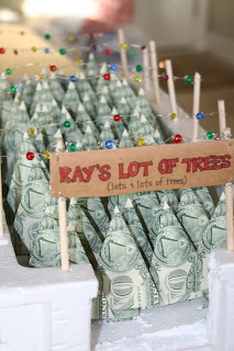 Creative Ways To Give Money As A Gift- a Christmas tree lot made out of dollar bills