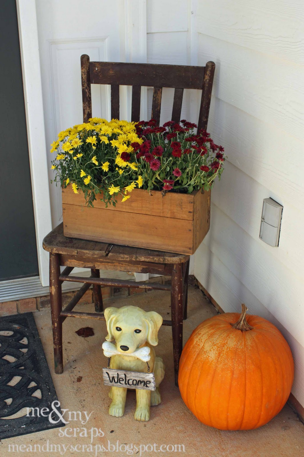Vintage decor makes great things to put on a front porch. Old vintage chair with a crate for a fall colored flowers. Pumpkin sitting on the porch and a dog statue holding a welcome sign