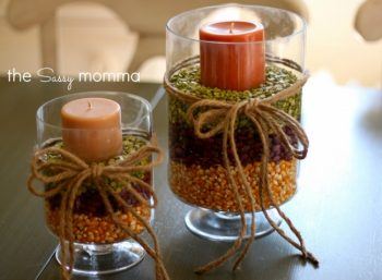 Fall centerpieces using corn and other grains and a candle