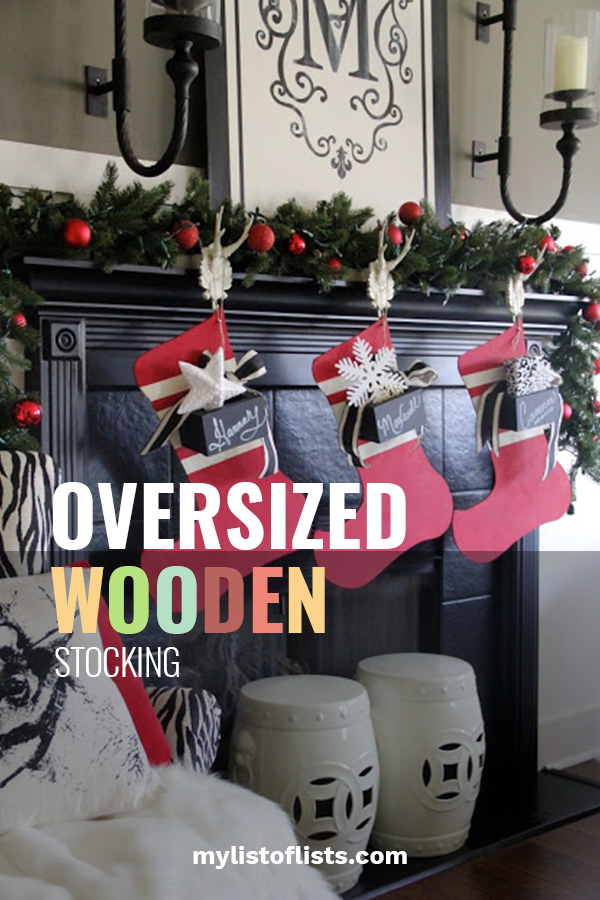 """You know what they say ... If the shoe (Stocking) fits. That is exactly what we are talking about. Calling all DIY enthusiasts who love to make their own holiday home decor. This oversized wooden stocking """"fits"""" all decor styles and adds such a festive touch to your home. Customize it with your family name, give as a gift, or decorate anyway you would like. Make more than one and have a family night painting and decorating. To learn more, keep on reading. #diyholidaydecor #DIYchristmasstocking"""