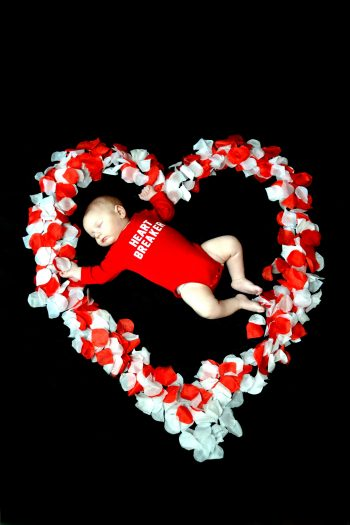 If you're looking for something cute to do on Valentine's Day this year, why not have a Valentine's photoshoot? Your baby will look so adorable.