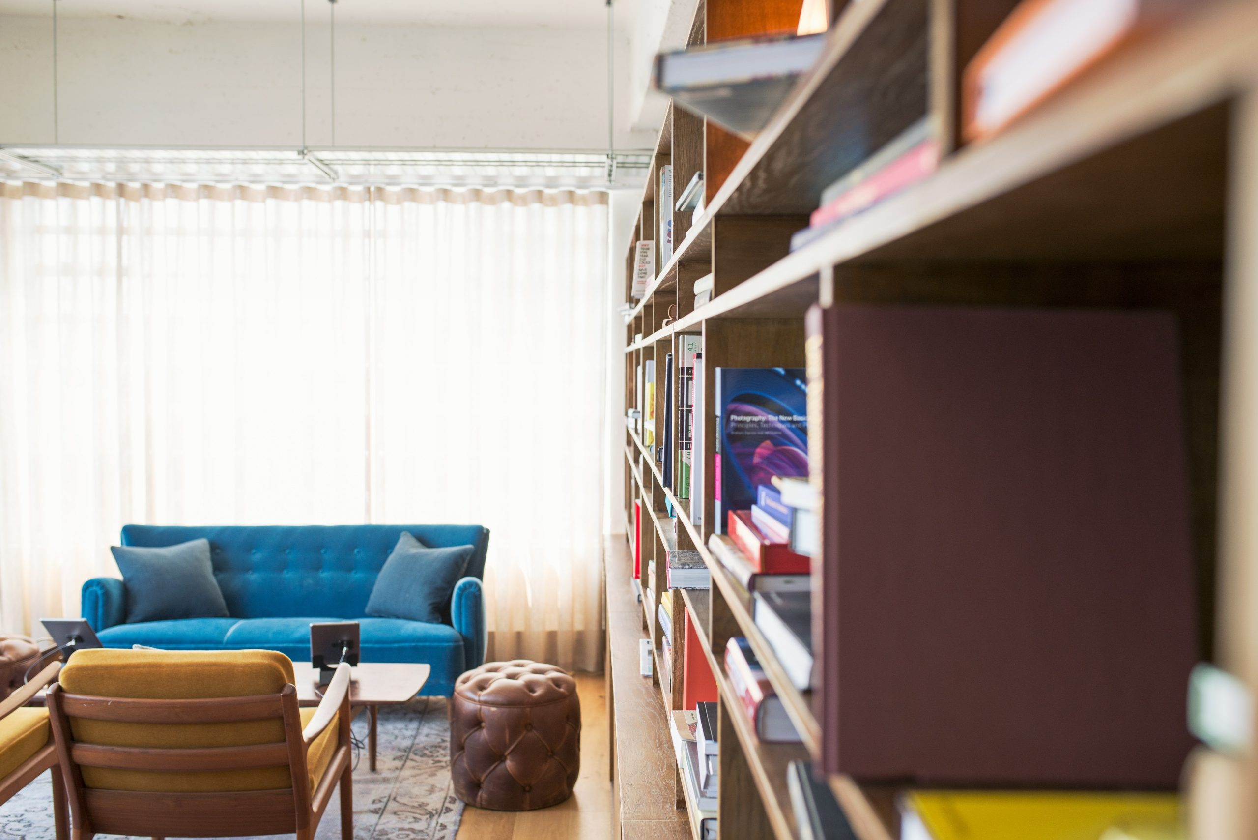 Have you heard of the book nook trend? A book nook is a cute little insert that tucks between the books on your bookshelf. It's basically a whole new (miniature!) world on your bookshelf. Pretty cool, right? Look here to see how to create a cozy book nook.