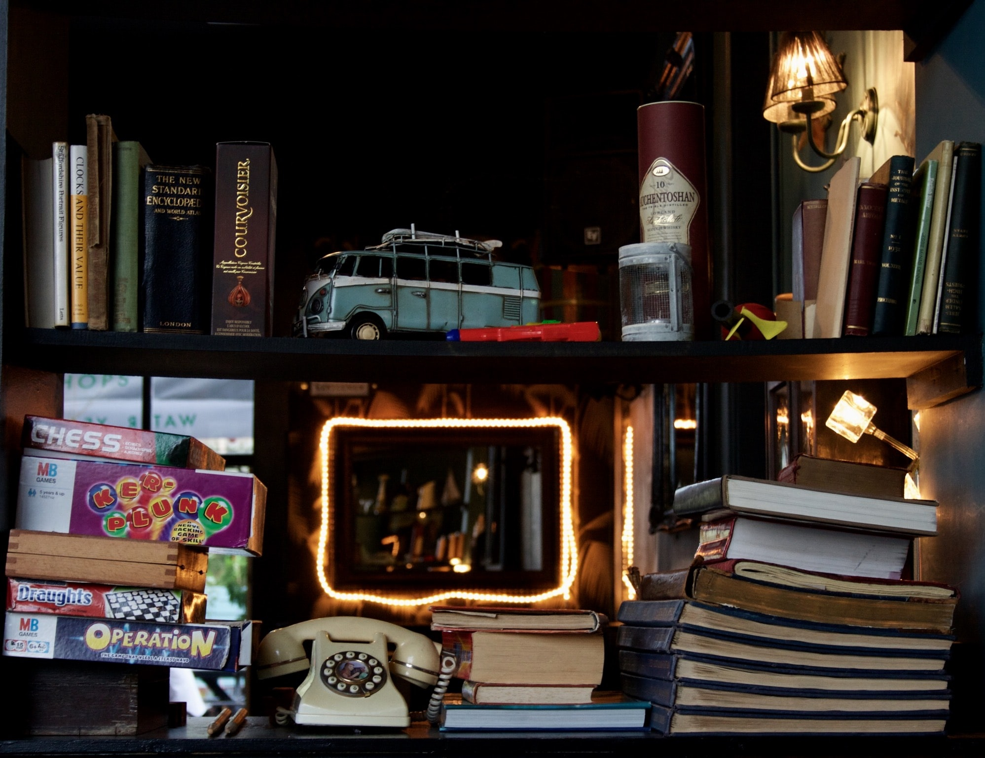 Have you heard of the book nook trend? A book nook is a cute little insert that tucks between the books on your bookshelf. It's basically a whole new (miniature!) world on your bookshelf. Pretty cool, right? Look here for the best book nook ideas!