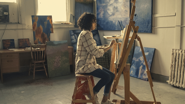 A woman painting on an easel - Scrap 'N Easel